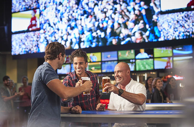 Men celebrating at Crown sports bar perth
