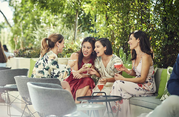 Group of women enjoying cocktails at TWR