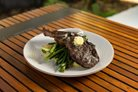 perfectly cookde steak on a bed of long beans at The Merrywell dining
