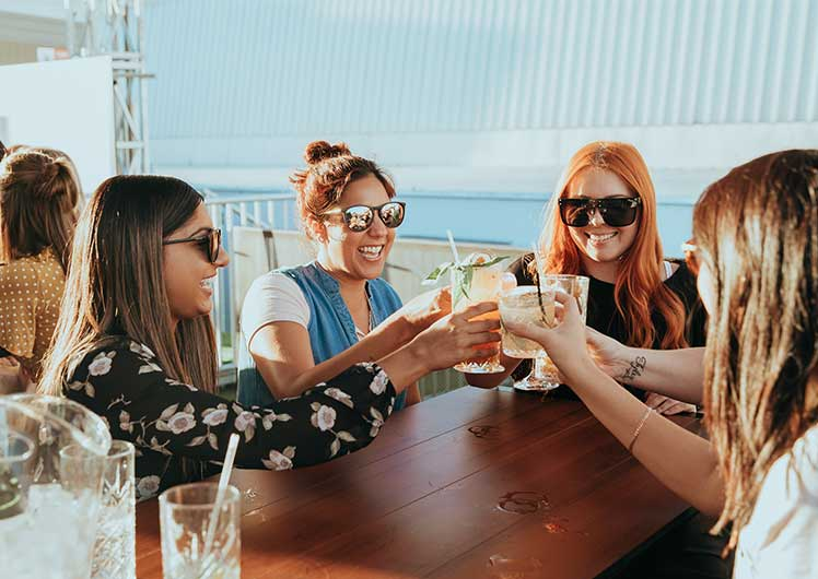 Girls Enjoying Cocktails at Hi-Line Rooftop Bar Crown Perth