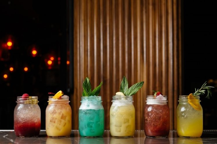 Refreshing summer cocktails in jars at The Merrywell bar