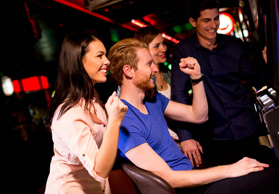 players celebrating win at crown perth casino gaming machines